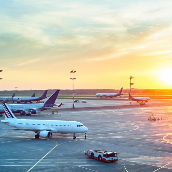Modern airport at sunset