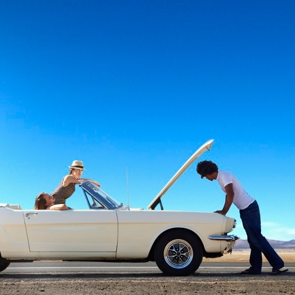Friends stranded with broken down convertible on remote road