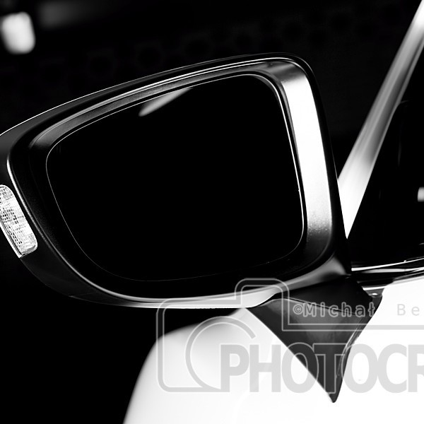 Modern luxury car wing mirror close-up