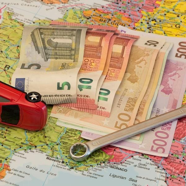 Map of Europe, broken car and euro money