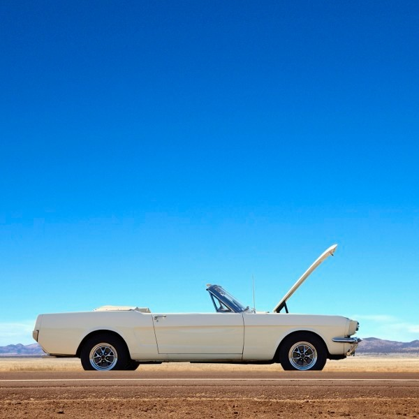 Broken down convertible abandoned on remote road